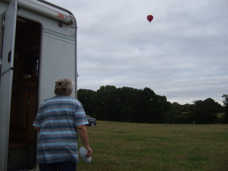 Sandra watches the balloon rising